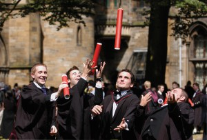Glasgow University Graduation - graduates throwing scrolls into air